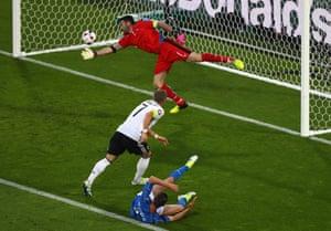 Bastian Schweinsteiger powers in a header but only after fouling De Sciglio.