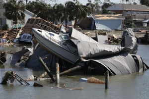 Damaged boats are seen in a marina