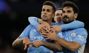 Manchester City's Joao Cancelo (left) celebrates with teammates.