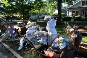Belongings are piled on a sidewalk as Waverly takes in the damage.