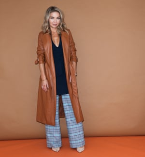Jess in wide-leg trousers and leather trench coat