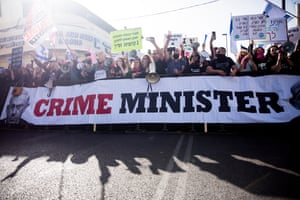 Protesters holding a banner reading 'Crime minister'