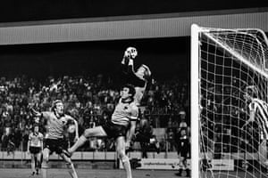 PSV's goalkeeper, Pim Doesburg, claims the ball under pressure from Wolves' captain, Emlyn Hughes, and Andy Gray in the fi rst leg at the Philips Stadium.