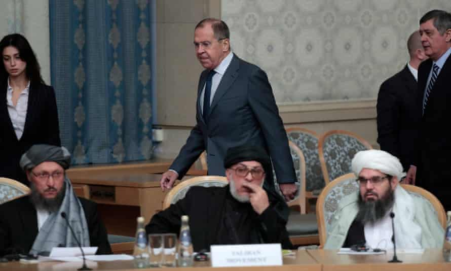 Sergei Lavrov passes members of the Taliban delegation before the start of the talks.