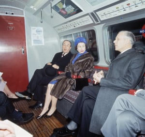 Queen Elizabeth II travels on a tube train after the official opening of the Victoria line in March 1969