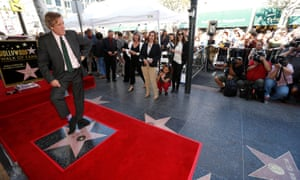 Actor Laurie poses on his star after it was unveiled on the Hollywood Walk of Fame.