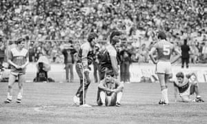 Meanwhile Everton's Adrian Heath, Neville Southall, Bobby Mimms (seated) Derek Mountfield and Kevin Sheedy try and come to terms with the defeat.