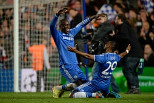 Demba Ba and Samuel Eto'o celebrate as Chelsea knock PSG out of the Champions League.