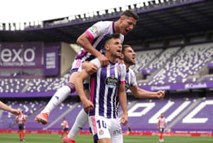 oscar plano of real valladolid celebrates with team mates after scoring their side's first goal.