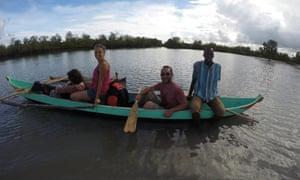 Ecotourists enjoy an outing in a pirogue in Kivalo, Madagascar
