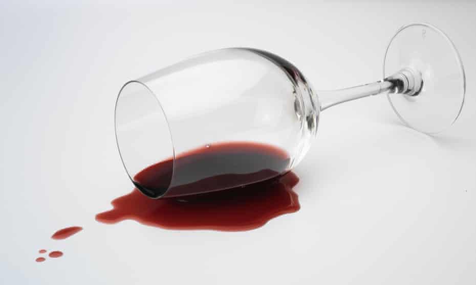 Spilt glass of red wine