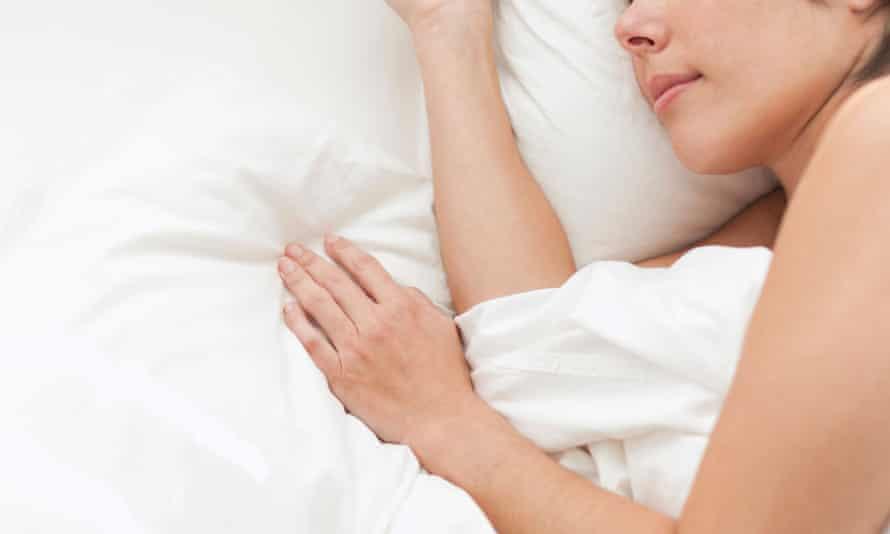 Hispanic woman sleeping in bed.