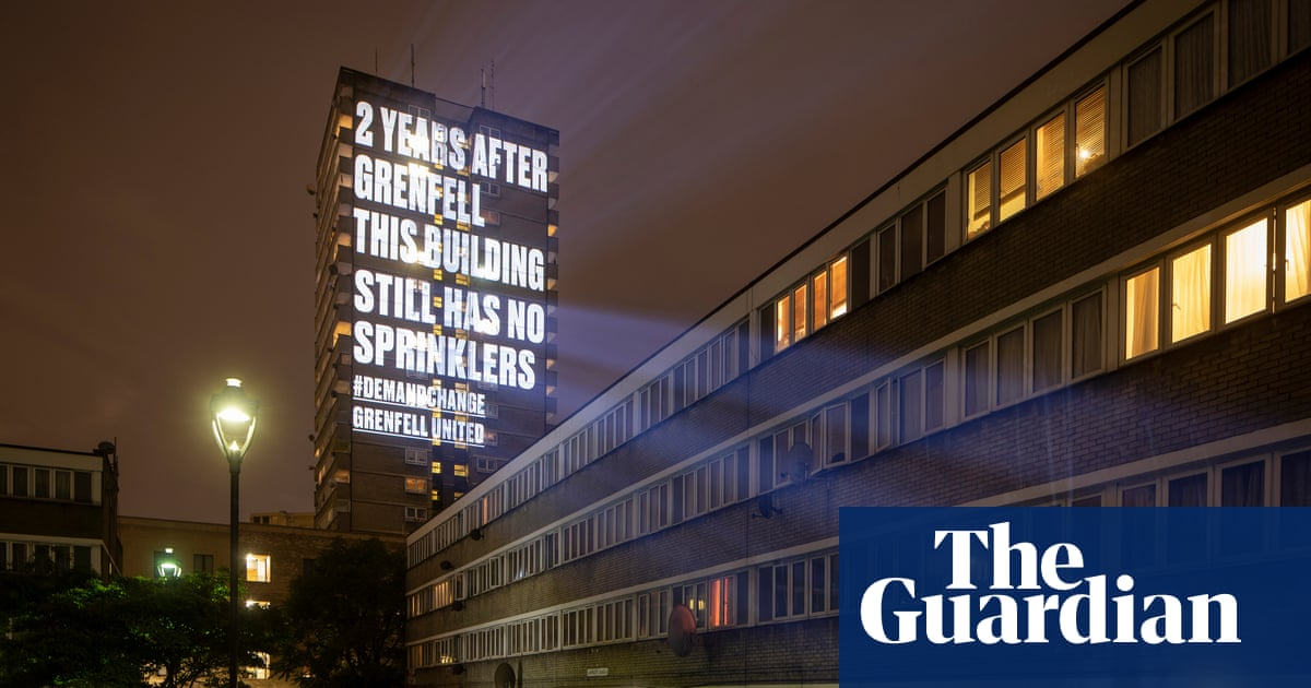'This building has no sprinklers': Grenfell United's 12-storey-high guerrilla messages
