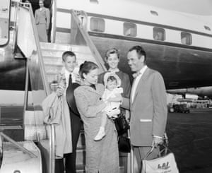 Fonda and his sister Jane (rear), with their father, the actor Henry Fonda, and his third wife, Susan Blanchard, who is holding their adopted daughter, Amy, at Idlewild airport before flying to Rome on holiday in June 1955
