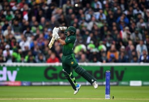Imam Ul Haq of Pakistan plays a shot into the air which is caught by Martin Guptill of New Zealand.