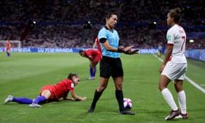 Referee Edina Alves Batista talks to Nikita Parris of England.