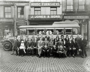 A group seated in front of the premises of J. Jones and Sons, House Furnishers, which were situated in Derby Market Place