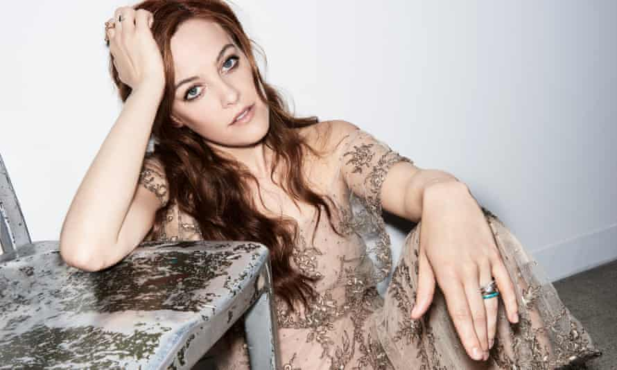 Riley wears dress by Dior; rings by Danielle Zino (courtesy of Broken English) and Eriness.