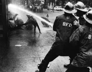 Firefighters turn their hoses full force on civil rights demonstrators July 15, 1963 in Birmingham, Alabama.