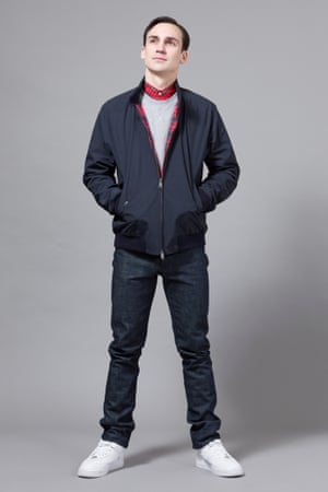 Henry Lloyd-Hughes wearing jacket by Baracuta, shirt by Fred Perry, sweatshirt by Sunspel, jeans by APC and trainers by Nike.