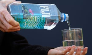Fiji Bottled Water being poured into a glass