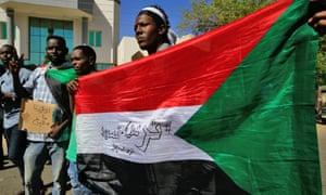 Demonstrators outside the foreign ministry in Khartoum