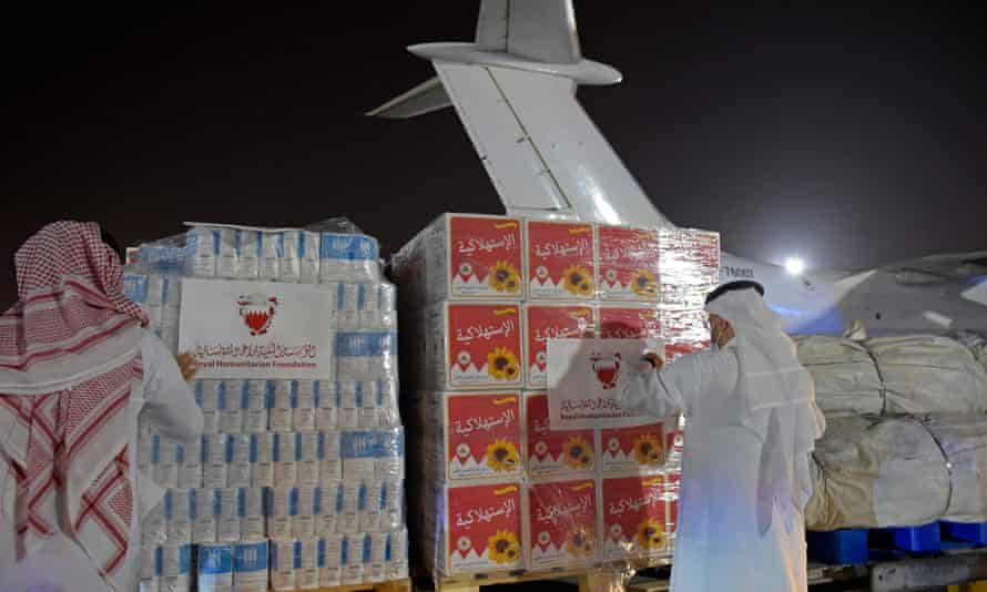 Volunteers label a shipment of humanitarian aid to be sent to Afghanistan at Bahrain international airport.
