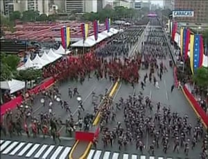 Soldiers scatter in Caracas after explosions during an address by president Nicolás Maduro.