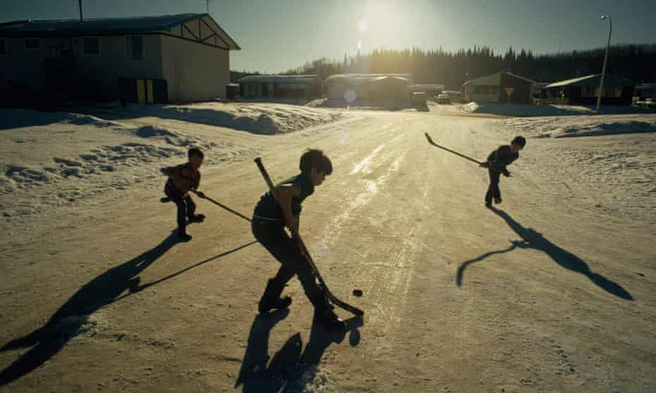 Boys play an impromptu game of hockey in a Fort McMurray street