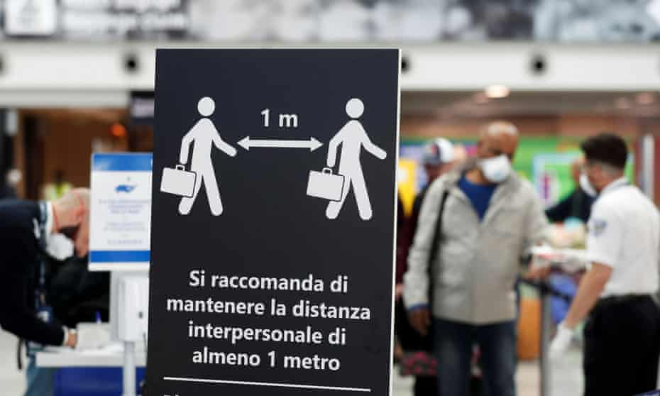A social distancing sign in Rome in March 2020