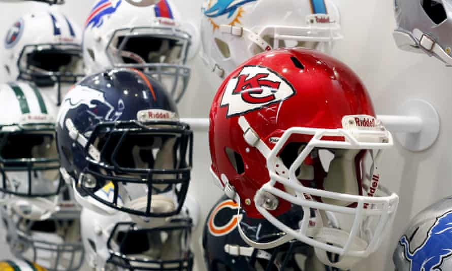 NFL team helmets are displayed at the NFL Headquarters in New York on 3 December 2015.