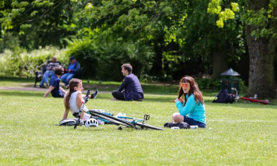 People enjoying warm weather in Finsbury park as they observe social distancing,17 May 2020