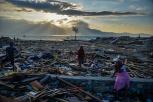 Palu, Indonesia Indonesians stand among debris at Mamboro village in Palu, Central Sulawesi, Indonesia, 05 October 2018. According to the Indonesian National Board for Disaster Management (BNPB) reports, at least 1,571 people have died as a result of a series of powerful earthquakes that hit central Sulawesi on 28 September 2018.