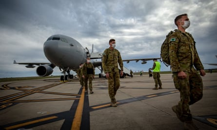 Australian defence force troops disembark at Avalon airport last week after being deployed to Victoria to assist in its coronavirus response.