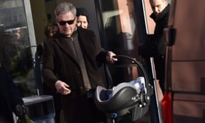 Finnish President Sauli Niinistö and spouse Jenni Haukio leave hospital with their new baby boy in Helsinki