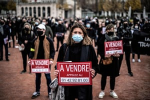 """Lyon, France Demonstrators hold a placard reading """"for sale"""" during a rally of shop owners calling for the reopening of their stores closed as part of measures taken by the government to close their establishments to curb the spread of the covid-19 pandemic"""