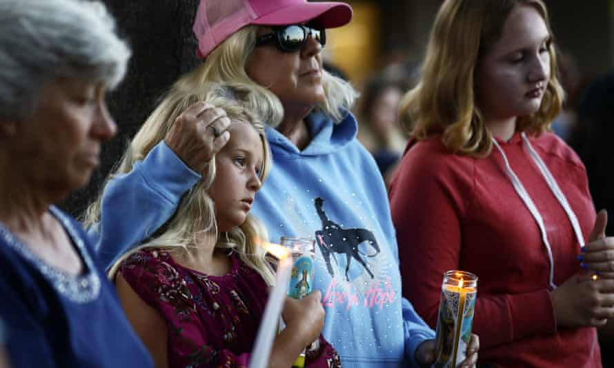 People attend a vigil for victims of the mass shooting at the Gilroy garlic festival.