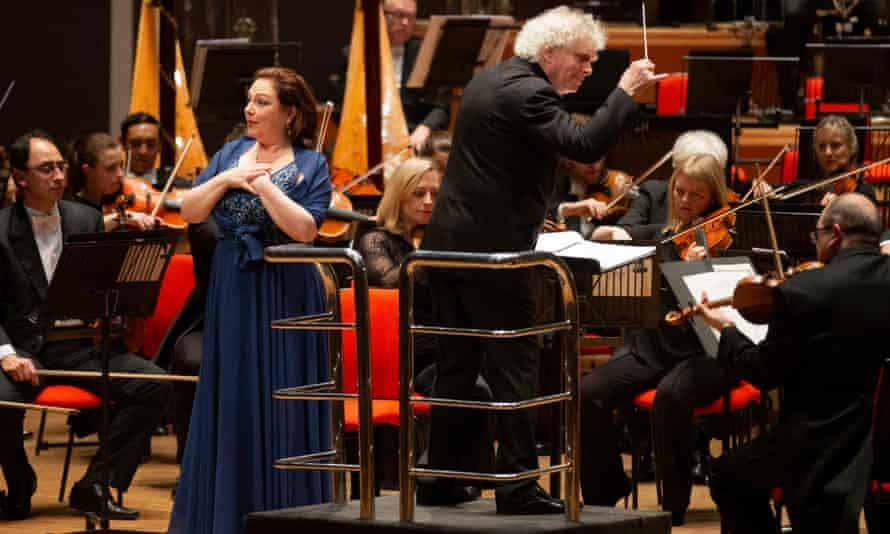 A bit too civilised ... Dorothea Röschmann, left, Simon Rattle and the London Symphony Orchestra at Symphony Hall, Birmingham.