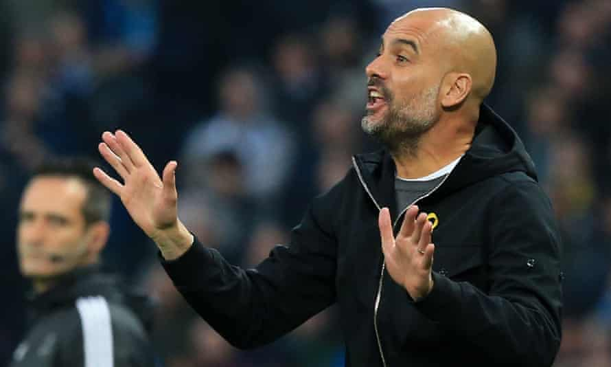 Pep Guardiola shouts instructions to his Manchester City players during the 2-1 Champions League defeat against Liverpool