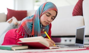 Middle eastern teenage girl with hijab studying at home