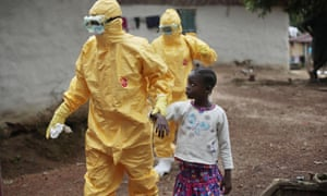 Nowa Paye, 9, is taken to an ambulance after showing signs of the Ebola infection in the village of Freeman Reserve Liberia.