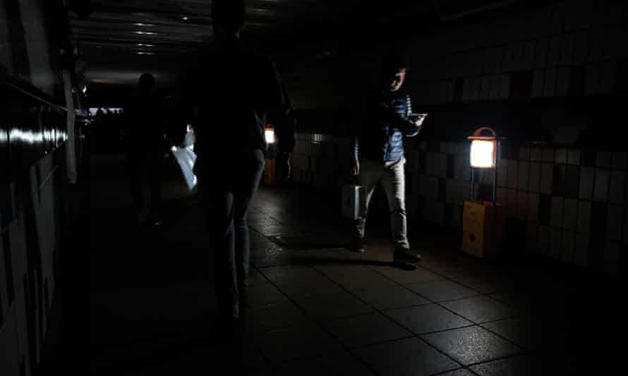 Temporary lighting in operation during the power cut in Clapham Junction train station in London.