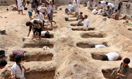 Yemenis dig graves for children killed when their bus was hit during a Saudi-led coalition airstrike in Sa'ada.