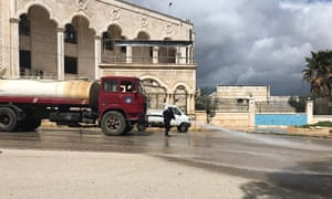 A street is disinfected in Latakia, Syria amid the coronavirus pandemic.