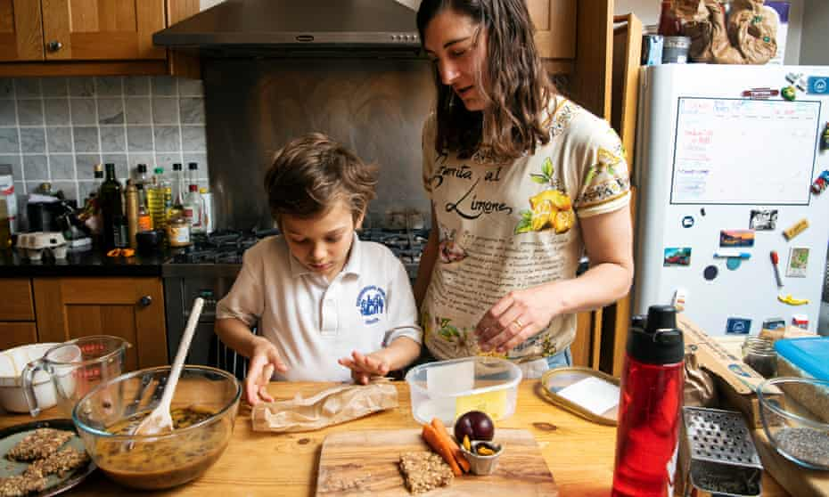 Paula Cocozza helps her son Gabriel create his own eco-friendly packed lunch