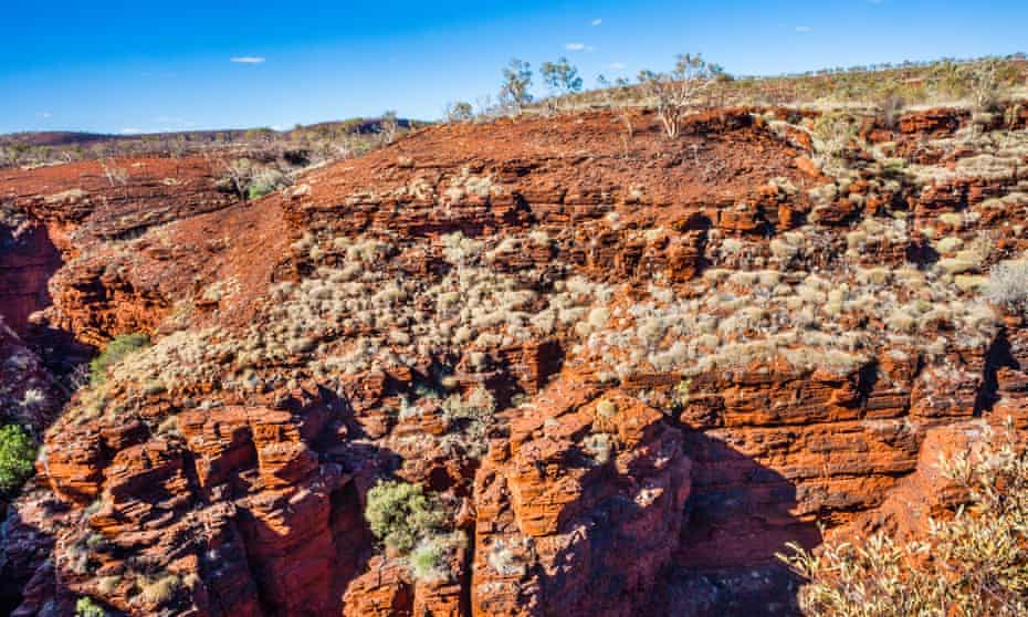 huge cliff face of red rock