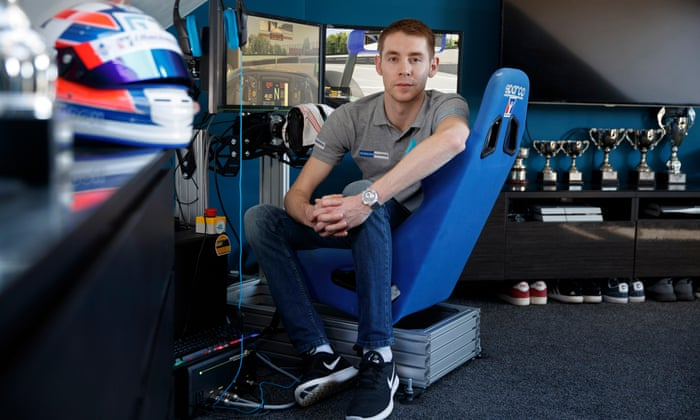 Graham Carroll, a sim-driver who competes in races from the rig set up in his bedroom, poses for a portrait in Musselburgh.