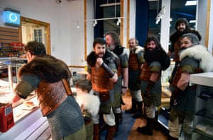 Participants dressed as Vikings eat breakfast as they prepare to participate in the annual Up Helly Aa festival
