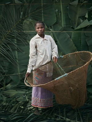 Matta Saffah, 27, holding homemade hooped nets used for fishing