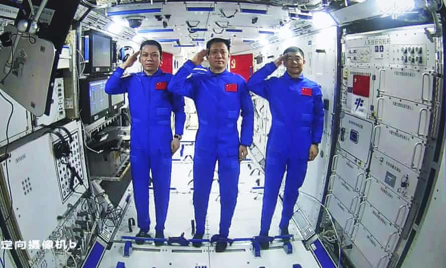 The astronauts onboard the station